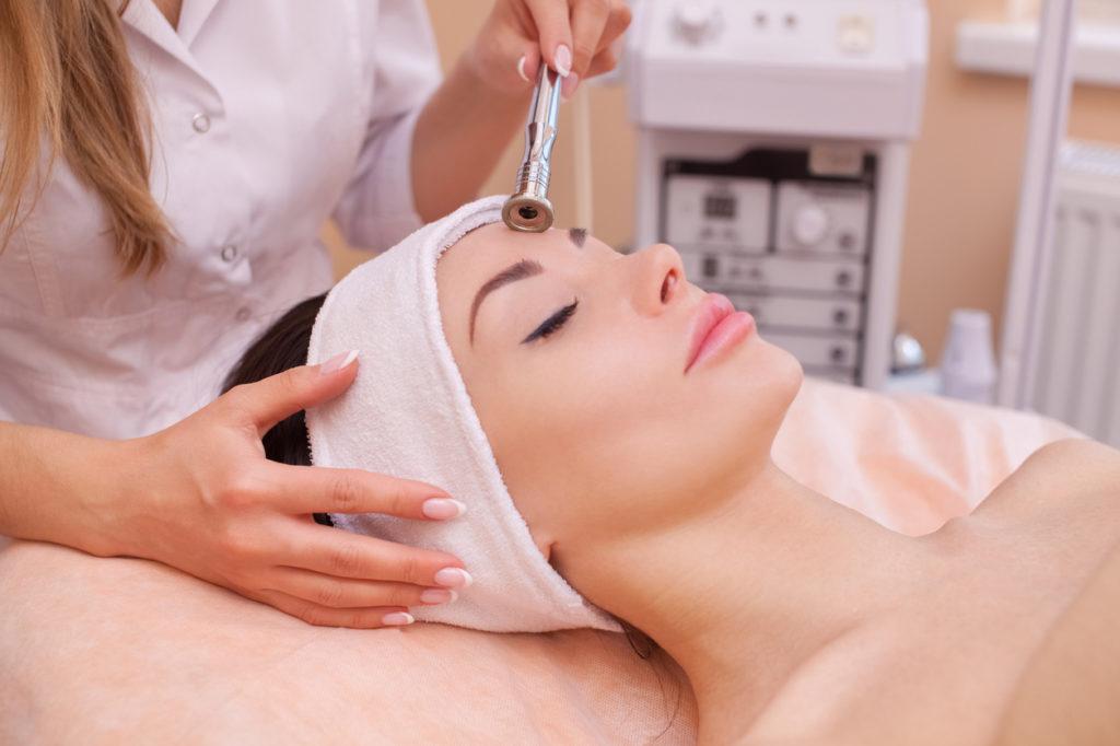 Dermatologist treating hyperpigmentation