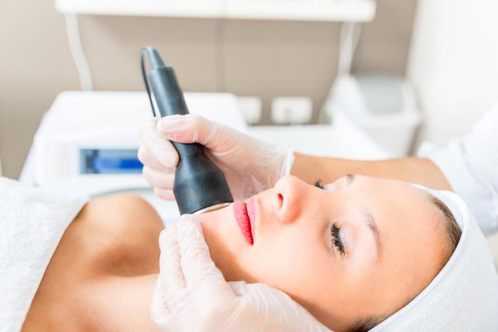 Woman getting skin resurfacing treatment